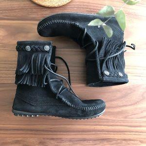 Minnetonka black fringe booties in a size 5
